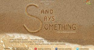 Sand says something