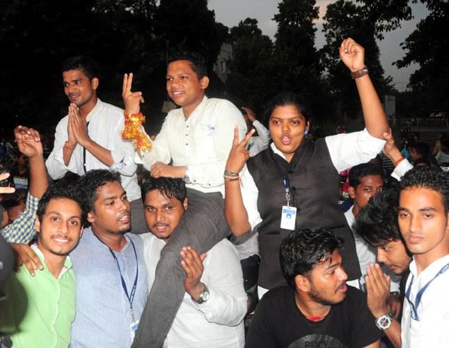 Utkal University students celebrating after campus poll