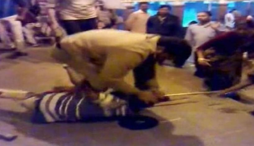 RPF personnel beating up a physically challenged person