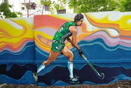 Colours from flags inspire wall paintings with spirit of hockey near Kalinga Stadium