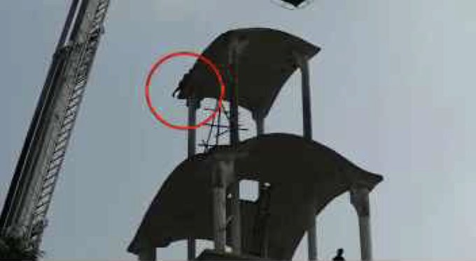 Man climbs atop Utkal University library building, threatens to commit suicide
